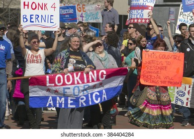 Asheville, North Carolina, USA - February 28, 2016:  Crowd of supporters at a Bernie Sanders rally hold signs and look for America in downtown Asheville, NC
