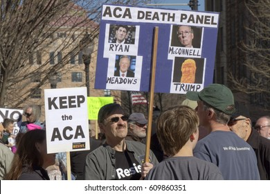 Asheville, North Carolina, USA - February 25, 2017: Obamacare activists hold signs saying Republicans Mark Meadows, Paul Ryan, Mitch McConnell and President Trump are the real ACA Death Panel