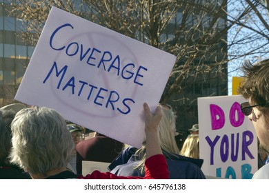 Asheville, North Carolina, USA - February 25, 2017:  Protesters hold signs at an Affordable Care Act rally saying that coverage matters as Republicans move to repeal Obamacare