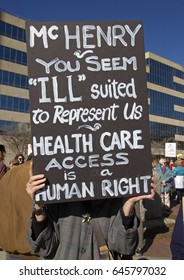"""Asheville, North Carolina, USA - February 25, 2017:  NC demonstrator holds a sign at an ACA rally saying """"McHenry, you seem """"ILL"""" suited to Represent Us â?? Health Care Access is a Human Right"""""""
