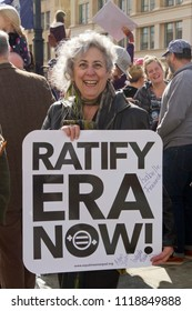ASHEVILLE, NORTH CAROLINA, USA - JANUARY 20, 2018: A female Baby Boomer in the 2018 Women's March holds a sign demanding the Equal Rights Amendment to the American Constitution be passed