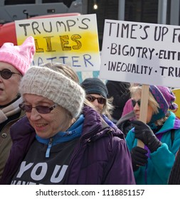 ASHEVILLE, NORTH CAROLINA, USA - JANUARY 20, 2018: Female Boomers in the 2018 Women's March hold signs about continued gender equality and racism in America and to protest Donald Trump's lies