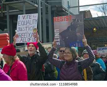 ASHEVILLE, NORTH CAROLINA, USA - JANUARY 20, 2018: People in the 2018 Women's March hold signs promoting equality, justice and freedom for all, including Dreamers, and say unite, resist and vote