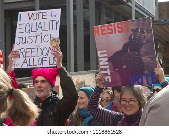 ASHEVILLE, NORTH CAROLINA, USA - JANUARY 20, 2018: Americans in the 2018 Women's March hold signs promoting equality, justice, freedom for all, including Dreamers, and say unite, resist and vote