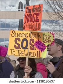 "ASHEVILLE, NORTH CAROLINA, USA - JANUARY 20, 2018: Protest sign at the 2018 Women's March says ""Banana Republicans, Suck Ups, Grow a Spine"" and ""This Is Not Normal"" and sends an SOS out to the world"