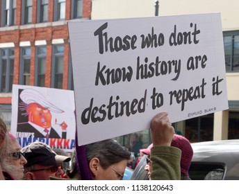 "ASHEVILLE, NORTH CAROLINA, USA - JANUARY 20, 2018: Protest signs at the 2018 Women's March say ""Trump's AmeriKKKa"" and ""Those Who Dont Know History are Destined to Repeat It"""