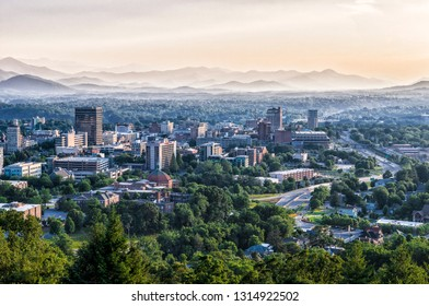 ASHEVILLE, NORTH CAROLINA, USA- JUNE 22, 2015: The skyline of downtown Asheville, North Carolina at sunset with mountains in the background