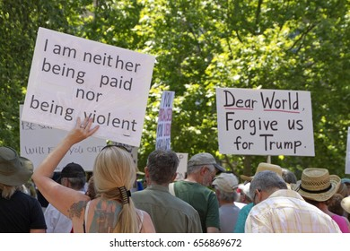 "Asheville, North Carolina, USA - June 3, 2017: Close up of a crowd of political protesters holding signs at a peaceful ""March For Truth"" rally with anti Trump messages"