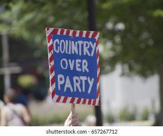 """Asheville, North Carolina, USA - June 3, 2017: A patriotic """"March For Truth"""" sign says """"Country Over Party"""" protesting Donald Trump and the Republican Party who supports him"""
