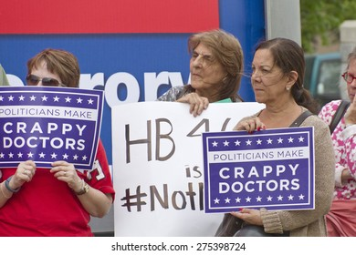 Asheville, North Carolina, USA - May 4, 2015:  Older women hold signs protesting North Carolina's abortion Bill #465 which increases restrictions for women seeking abortions
