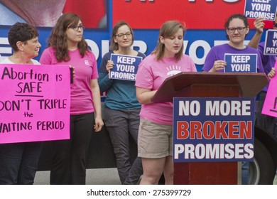 Asheville, North Carolina, USA - May 4, 2015:  Crowd holds signs asking NC Governor McCrory to keep his promise to not further restrict access to abortion at a rally protesting NC abortion bill #465