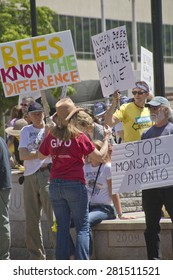 Asheville, North Carolina, USA - May 23, 2015: American activists hold signs protesting genetically modified foods and the Monsanto Corporation in a grass roots event