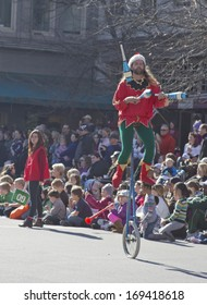 Asheville, North Carolina, USA - November 17, 2012: A juggler dressed as an elf rides a unicycle in the annual Christmas Parade on November 17, 2012 in downtown Asheville, North Carolina