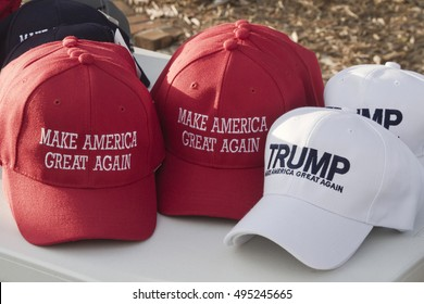 "Asheville, North Carolina, USA: September 12, 2016: Colorful ball caps being sold at a Donald Trump campaign rally with the slogan ""Make America Great Again"" on September 12, 2016 in Asheville, NC"