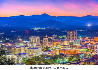 Asheville, North Carolina, USA skyline over downtown with the Blue Ridge Mountains.