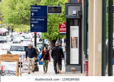 Asheville, USA - April 19, 2018: Downtown old town street in North Carolina NC famous town, city with stores, shops, sign for art gallery, Biltmore, cultural center