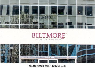 Asheville, USA - April 19, 2018: Downtown old town hipster North Carolina NC famous town, city with closeup sign for Biltmore corporate offices
