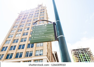 Asheville, USA - April 19, 2018: Direction and tourist information sign to Biltmore, Pack Square Park in downtown of North Carolina city with buildings, offices