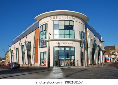 ASHFORD, ENGLAND - DECEMBER 8, 2008: Exterior of the Debenhams department store at Ashford in Kent. Opened in March 2008, it is one of 22 Debenhams stores scheduled to close in 2020.