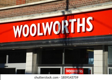 ASHFORD, ENGLAND - DECEMBER 8, 2008: Exterior of a Woolworths store in the High Street. All 807 branches closed down in the UK between December 2008 and January 2009.