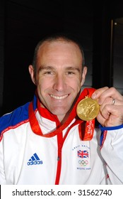 ASHFORD, ENGLAND - NOVEMBER 23: Jamie Staff, member of the British cycling team, holds the gold medal he won at the 2008 Beijing Olympics, at an event on November 23, 2008 in Ashford, Kent.