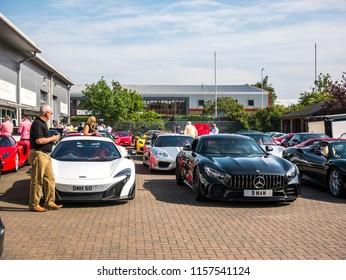 ASHFORD, KENT / UK - MAY 29 2018: Enthusiasts gather at Simon Furlonger cars of Ashford, Kent for a meeting and drive to Hythe.