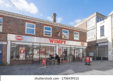 Ashford, Kent, United Kingdom - March 9, 2020: Wimpy burger and fast food restaurant on Tufton Street in Ashford town centre, UK