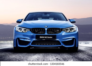 Ashgabad/Turkmenistan-01.22.2017;Blue sports car BMW M3 on a winding mountain road