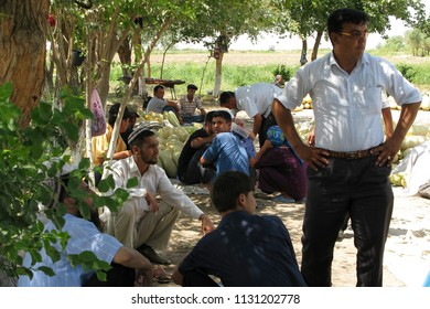 Ashgabat, Turkmenistan - 1 July 2007 : Street scene of people in rural Turkmenistan. Turkmenistan is one of the hardest-to-reach countries in the world due to goverment restriction on visa approval.