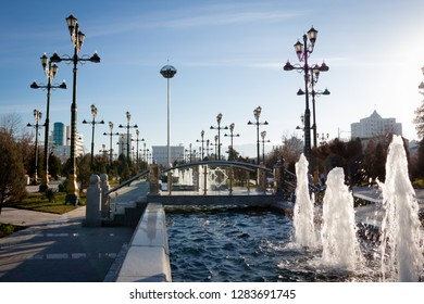 """Ashgabat, Turkmenistan. 13 January 2019, """"Ylham"""" (enlightenment) Alley. Beautiful fountains crossing the alley."""