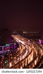 Ashgabat, Turkmenistan. 18 December 2018. City at night. Motion on a highway at night in a rainy weather.