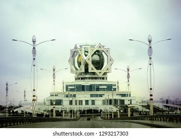 Ashgabat, Turkmenistan. 18 December 2018. A road leading to a wedding hall in a dailight. Modern structure with a sphere framed with octagon shaped star on the top.