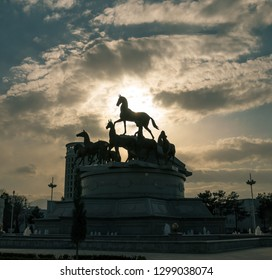 Ashgabat, Turkmenistan. 26 January 2019. Monument of 10 horses in a downtown Ashgabat. highlighted the silhouette of the central horse on the top.