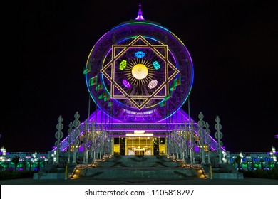 ASHGABAT, TURKMENISTAN - CIRCA SEPTEMBER 2013: Night view of the well-lit indoor ferris wheel, the largest of its kind on the world.