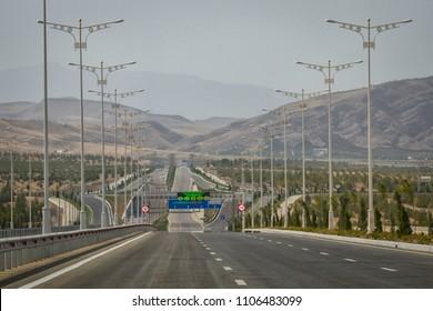 ASHGABAT, TURKMENISTAN - CIRCA SEPTEMBER 2013: New empty highway on the outskirts of Ashgabat.