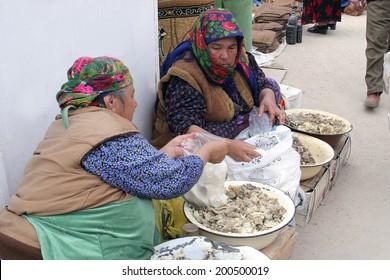 Ashgabat, Turkmenistan - February 26.  Portrait of two unidentified  Asian women. Oriental bazaar. Ashgabat, Turkmenistan -  February  26. 2013