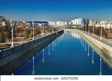 ASHGABAT, TURKMENISTAN, January 25, 2017:  Modern architecture of Ashgabat. View of the water channel. ASHGABAT, TURKMENISTAN, January 25, 2017.