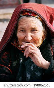 Ashgabat, Turkmenistan - July 29.  Portrait of old unidentified  Asian woman. Woman in traditional national dress. Oriental bazaar.  Ashgabat, Turkmenistan - July 29. 2013.