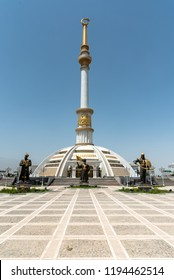 ASHGABAT, TURKMENISTAN  - JUNE 06, 2018: typical white marble-clad building surrounded by fountains in the Independance Park in Ashgabat, Turkmenistan