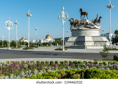 ASHGABAT, TURKMENISTAN  - JUNE 07, 2018: horse statue in front of the presidential palace in Ashgabat, Turkmenistan