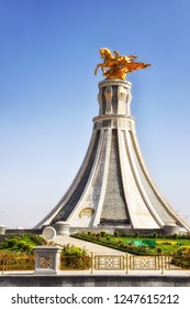 Ashgabat, Turkmenistan - October 06, 2015:  One of many horse monuments in Turkmenistan towers over the roadside in the outskirts of Ashgabat.
