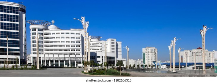 Ashgabat, Turkmenistan - October 15, 2015: Modern architecture of Ashgabat. Wide boulevard with some new buildings. Ashkhabad. Turkmenistan in October 15, 2015.