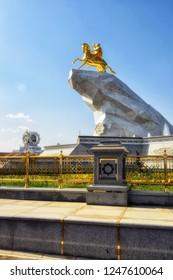 Ashgabat, Turkmenistan - October 6, 2015. Monument to President of Turkmenistan Gurbanguly Berdimuhamedov. Ashgabat, Turkmenistan