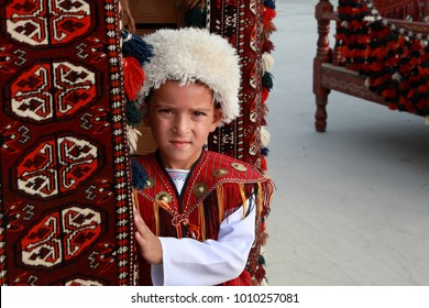 Ashgabat, Turkmenistan - September, 12, 2017.  Portrait of  unidentified serious  Asian boy.  Boy in traditional national  clothes.