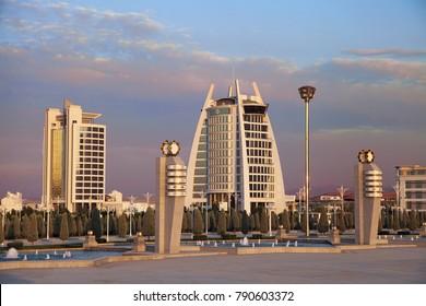 Ashgabat, Turkmenistan -  September 26,  2017 : Modern architecture of Ashgabat. A wide boulevard with new administrative buildings at sunset.