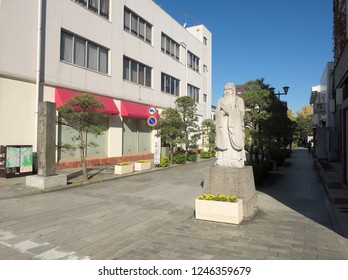 ASHIKAGA, TOCHIGI / JAPAN – NOVEMBER 24, 2018: A stone statue to Confucius who is one of Chinese philosopher at the entrance of the path to Ashikaga Gakko in Tochigi, Japan.