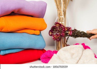 ashion clothes on clothing rack - bright colorful closet. Closeup of rainbow color choice of trendy female wear on hangers in store closet or spring cleaning concept. Summer home wardrobe.