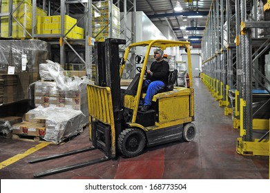 ASHKELON, ISR - AUG 08:Forklift truck on August 08 2009.Forklift was developed in the early 20th century. In 2013 the top 20 manufacturers worldwide sold 944,405 machines in worth of $30.4 million.