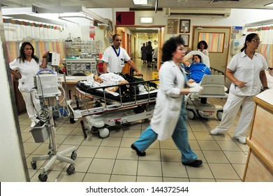 ASHKELON, ISR - AUG 22:Madical staff on duty in Barzilai medical center emergency department on Aug 22 2010. The emergency departments of most hospitals in the world operate 24 hours a day.