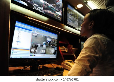 ASHKELON, ISR - JAN 18:CCTV security system operator on Jan 18 2009.Approx 25 million CCTV cameras are operating around the world.